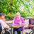 group of seniors playing board game on terrace of retirement hom stock photo © kzenon