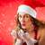attractive woman as santa claus blowing snow stock photo © kzenon
