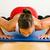 woman doing pushups in gym stock photo © kzenon