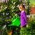 happy child watering flowers in the garden stock photo © kzenon