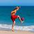 man on beach playing soccer stock photo © kzenon