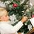 child lighting christmas candles stock photo © kzenon