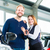 young people or couple with auto in car dealership stock photo © kzenon