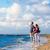 カップル · ロマンチックな · 徒歩 · 海浜砂 · 手 - ストックフォト © kzenon
