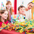 child unwrapping birthday gift with friends stock photo © kzenon