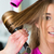 woman at the hairdresser having hair dried stock photo © kzenon