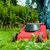 man is mowing the lawn in summer stock photo © kzenon