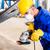 metal worker in factory grinding metal of pipeline stock photo © kzenon
