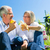 senior couple eating and drinking at picnic in summer stock photo © kzenon