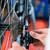 bike mechanic working on gears of bicycle stock photo © kzenon