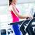 sportive girl doing workout on treadmill stock photo © kzenon