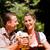 boldog · pár · ül · sör · kert · élvezi - stock fotó © Kzenon