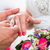 groom slipping ring on finger of bride at wedding stock photo © kzenon