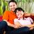 asiático · casal · espaçoso · casa · sofá · indonésio - foto stock © kzenon