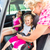 mother buckling up on child in car safety seat stock photo © kzenon