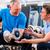 senior man and trainer at exercise in gym stock photo © kzenon