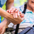 nurse consoling senior woman holding her hand stock photo © kzenon