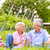 happy seniors having picnic drinking wine stock photo © kzenon