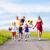 family running down hill in summer stock photo © kzenon