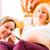 Midwife seeing mother for pregnancy examination stock photo © Kzenon
