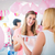 woman giving gift to pregnant friend on baby shower stock photo © kzenon