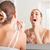 Young woman brushing teeth at wash bowl  stock photo © Kzenon
