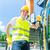 asian builder with excavator on construction site stock photo © kzenon