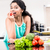 indian woman eating healthy apple in her kitchen stock photo © kzenon