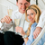 business couple at home with champagne stock photo © kzenon
