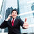 Asian business man talking outside to mobile phone stock photo © Kzenon