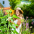 woman gardener standing in the garden stock photo © kzenon