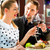 friends or couple eating and drinking in fast food diner stock photo © kzenon