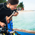 woman diver testing regulator before scuba diving stock photo © kzenon