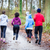 fitness trainer guiding group of four determined young people du stock photo © kzenon