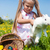 girl hugging an easter bunny with eggs on a meadow in spring stock photo © kzenon