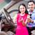 asian couple choosing luxury car in dealership stock photo © kzenon