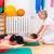 physiotherapist giving patients gymnastic exercise stock photo © kzenon