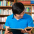 student in library reading book stock photo © kzenon