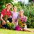 family gardening in garden having fun stock photo © kzenon