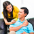 asian woman feeding boyfriend on sofa or couch stock photo © kzenon