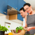 couple cooking together in kitchen stock photo © kzenon