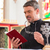 priest reading bible in church standing at altar stock photo © kzenon