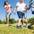 family playing football or soccer in park in summer stock photo © kzenon