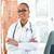 retrato · jóvenes · femenino · médico · clínica · negro - foto stock © Kzenon