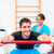young man working out in physical therapy on swiss ball with gym stock photo © kzenon