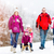 family having winter walk in snow with sled stock photo © kzenon