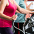 elderly woman training on cross trainer at the gym stock photo © kzenon