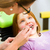 dentist practicing with child in dental surgery stock photo © kzenon