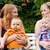 mother and grandmother with children in a park stock photo © kzenon