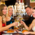 Friends in a very good restaurant clink glasses stock photo © Kzenon